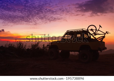 Off Road Car On The Mountain Silhouette shot - stock photo