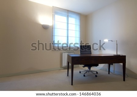 office room interior with desk - stock photo