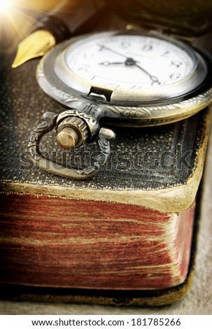 Old book and pocket watch (macro photo) - stock photo