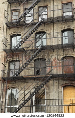 Old building with outdoor staircase (New York City, USA) - stock photo