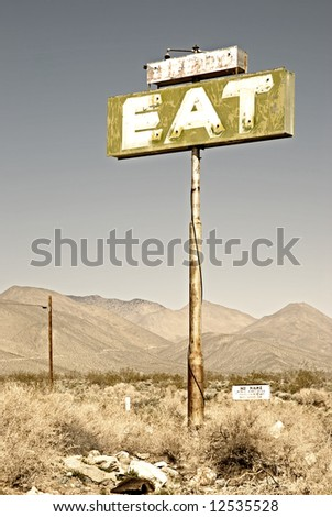 """Old cafe sign with the word """"eat"""" by pearsonville california.usa - stock photo"""