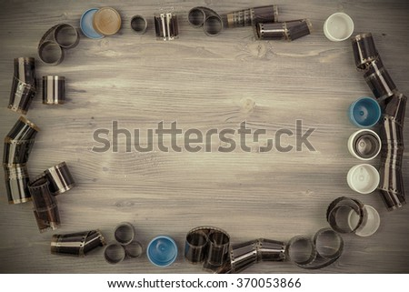 Old film with case on Wooden background  - stock photo