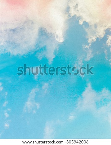 Old paper with dreamy clouds in blue sky