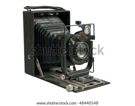 old photo camera isolated on white background - stock photo