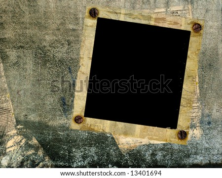 old photo frame on the wall - stock photo