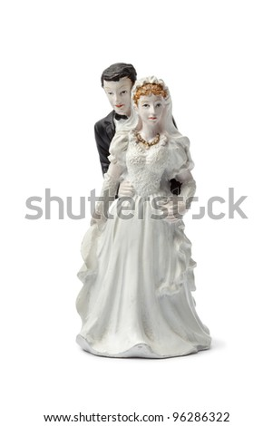 Old plaster bride and groom cake topper isolated on white background - stock photo