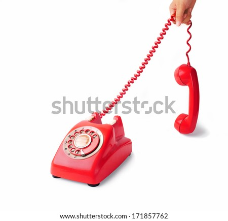 old red telephone with rotary dial - stock photo