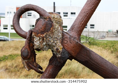 old rusty anchor in the port. Denmark - stock photo