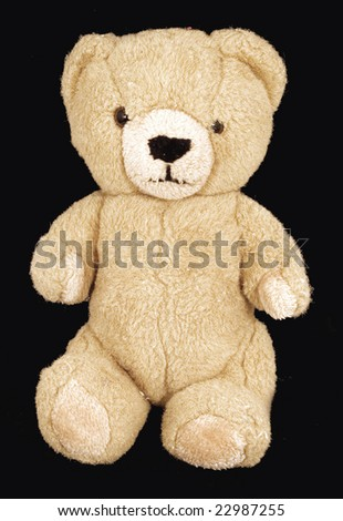 old small teddy   on black - stock photo
