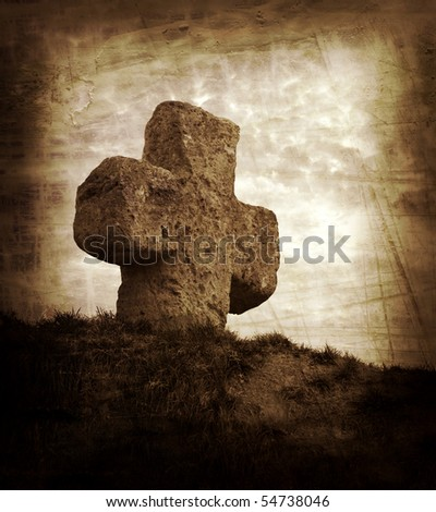 old stone cross on the background of a beautiful sunset - stock photo