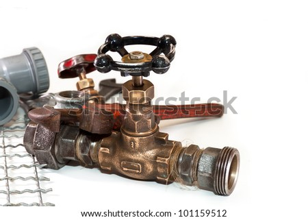 old tap water and tools for plumbing on a white background - stock photo