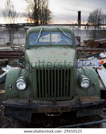 Old truck in dump - stock photo
