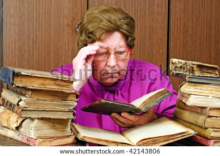 old woman in library with religious book - stock photo