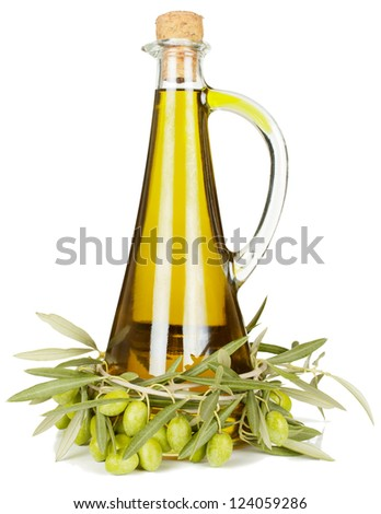 Olive oil in a glass bottle and a branch of an olive tree with fruits. . Isolated on a white background.