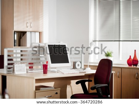 ?omputer with LCD screens in modern office - stock photo