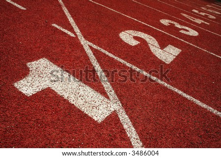 1 2 3 on a running track finish line - stock photo