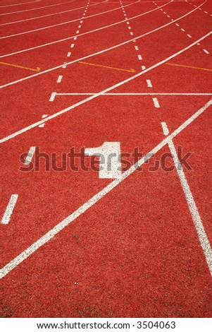1 on a running track finish line - stock photo