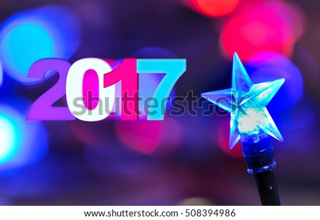 2017 on blur lights and  bulb star shaped of an electric garland