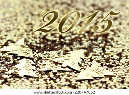 2015 on golden confetti and glitters background