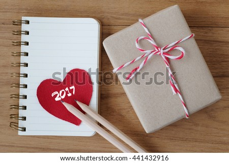2017 on red fabric heart shape , gift box and note paper on wood background, holiday, valentines present - stock photo