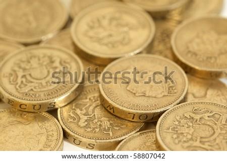 One Pound coins arranged on a  white background - stock photo