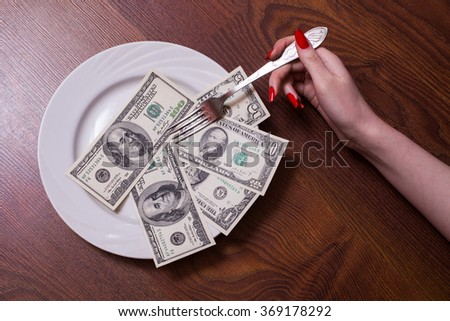 one, ten, one hundred dollar bill face, old banknotes lie on a plate, female hand with red fingernails holding a fork, Breakfast of Champions millionaires, new  brilliant conceptual idea, photography