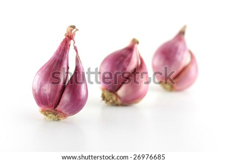 3 onion in a row. - stock photo