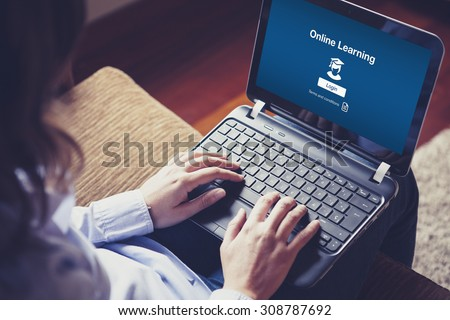 """Online Learning"" on the screen. Woman hands over the laptop keyboard. - stock photo"