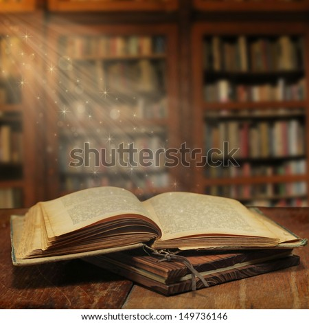 Opened magic book with magic light - stock photo