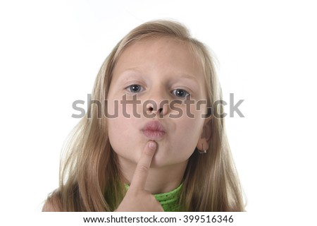 6 or 7 years old little girl with blond hair and blue eyes smiling happy posing isolated on white background showing her lips in language lesson for child education and body parts school chart set - stock photo