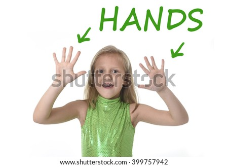 6 or 7 years old little girl with blond hair and blue eyes smiling happy posing isolated on white background showing hands  in learning English language school education body parts card set - stock photo