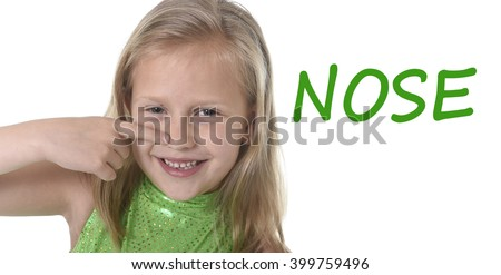 6 or 7 years old little girl with blond hair and blue eyes smiling happy posing isolated on white background pointing nose  in learning English language school education body parts card set - stock photo