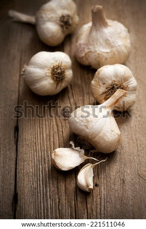 organic garlic on wooden board - stock photo