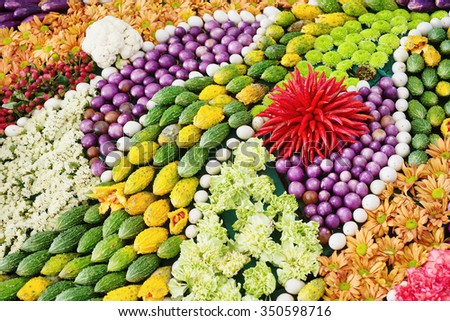 Organic vegetables gourd eggplant red yellow green red purple peppers - stock photo
