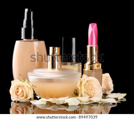 ?osmetics with roses isolated on black - stock photo