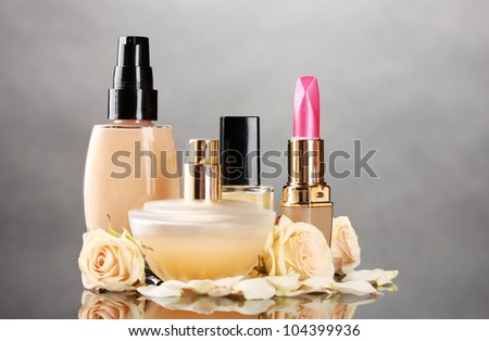 ?osmetics with roses on gray - stock photo