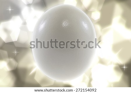 Ostrich egg  on bokeh background - stock photo