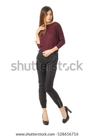 �£oung beautiful woman in burgundy blouse and black trousers