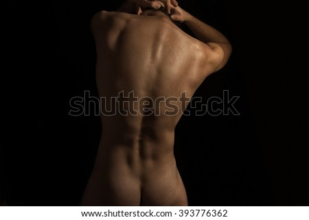 Нoung naked man on a black background - stock photo