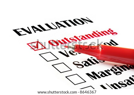 """Outstanding"" checked on evaluation form, with red pen. - stock photo"