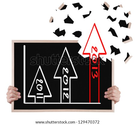 2013 over achievement  growth graph on blackboard with hands - stock photo