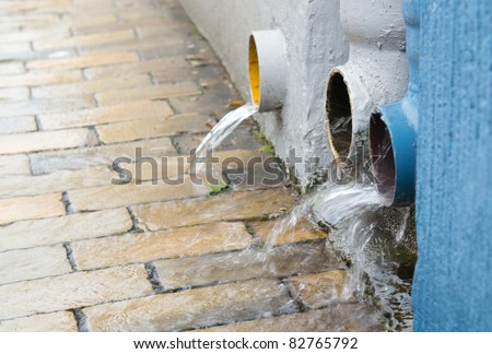 overflowing pipes, downpour - stock photo