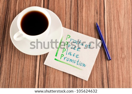 4P on a napkin and cup of coffee - stock photo