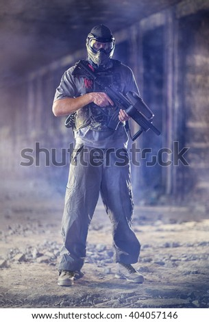 Paintball  man player with marker gun  - stock photo