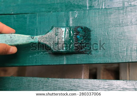 Painting brush with green color - stock photo