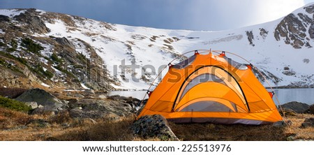 Panorama Camping by the lake in Colorado Mountains. - stock photo