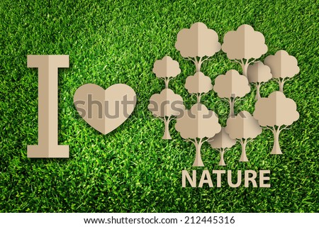 Paper cut of eco on green grass