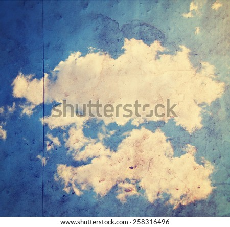 paper texture background with a clouds image overlay toned with a retro vintage instagram filter app or action effect - stock photo