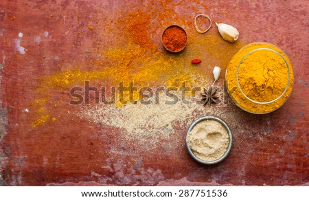 (Paprika, Turmeric, Ginger) Spices and herbs on wood background, top view indian spices and herbs difference ware on wood background with copy space for design spices, herbs or foods content. - stock photo