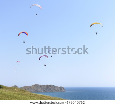 Paragliders in the sky above the sea